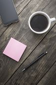 Smart Phone  With Sticky Note Paper And Cup Of Coffee
