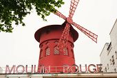 Paris, France - May21: Moulin Rouge. Advertising Cabaret Show On Facade Of Moulin Rouge, Famous Caba