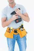 Cropped image of technician holding handheld drill over white background