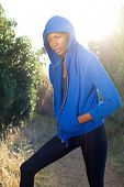 Female Fitness Model Posing With Blue Sweatshirt Outdoors