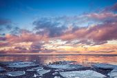 Winter Coastal Landscape With Floating Ice On Sea And Clouds