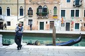 Gondolier Leaning Against Pillar