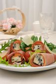 Rolls Of Jamon With Blue Cheese In Lettuce Leaves And Parmesan