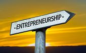Entrepreneurship sign with a sunset background