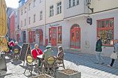 Tallinn. Estonia. Mature people in open air cafe. Old Town