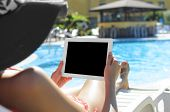 Woman With Tablet At Swimming Pool