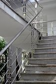 Stairs with a metal railing