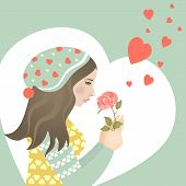 Beautiful girl in love with rose
