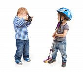 Two toddler boys playing with a camera