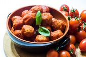 picture of pot roast  - meatballs in ceramic pot with tomatoes in white background - JPG