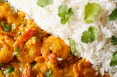 Shrimps Curry With Rice And Cilantro Macro. Horizontal Top View