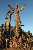 SIAULIAI, LITHUANIA - AUGUST 1, 2013: Wooden statue of Jesus Christ at the Hill of Crosses, the most important Lithuanian Catholic pilgrimage site near the town of Siauliai in Northern Lithuania.
