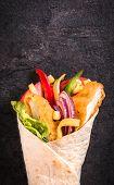 foto of sandwich wrap  - Chicken wrap sandwich on dark background with blank space - JPG