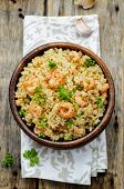 stock photo of quinoa  - quinoa with shrimp and parsley on a dark wood background - JPG