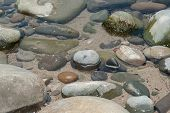 picture of tide  - Tops of rocks become exposed at low tide - JPG