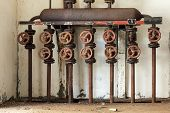 stock photo of steam  - Steam distribution manifold in an old abandoned distillery - JPG