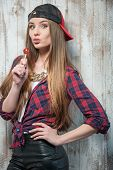 foto of lollipops  - Waist up portrait of pretty hipster girl with Caucasian appearance - JPG