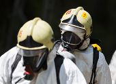 image of decontamination  - A team working with toxic acids and chemicals is approaching a chemical cargo train crash near Sofia Bulgaria. Teams from Fire department are participating in an emergency training with spilled toxic and flammable materials. ** Note: Shallow depth of fie - JPG