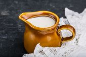 picture of jug  - jug with milk on a black background - JPG