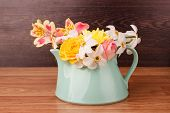 stock photo of teapot  - Light blue teapot with flowers on a wooden background - JPG