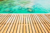 stock photo of whore  - Wooden walkway bridge at beautiful sea coast - JPG