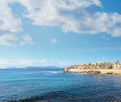 picture of shoreline  - Alghero shoreline on a cloudy spring day - JPG