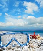 image of sky diving  - diving mask and shells under a cloudy sky - JPG