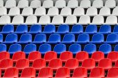 stock photo of grandstand  - Empty grandstand with Seating in the colors of the Russian flag - JPG