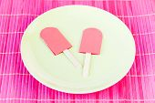 image of paper craft  - Pink paper craft popsicles on a green plate - JPG