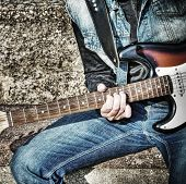 image of guitarists  - close up of a guitarist playing on the street in hdr tone mapping effect - JPG