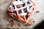 stock photo of cherry pie  - Homemade cherry pie on  old wooden table - JPG