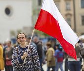 foto of polonia  - Young woman on the street with the flag of Republic of Poland - JPG