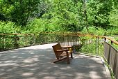 stock photo of observed  - Nature reserve observation deck with natural cedar seating in summer - JPG