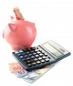 image of calculator  - Calculator and piggy bank with Canadian dollars - JPG
