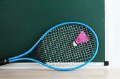 picture of shuttlecock  - Tennis racket and shuttlecocks on blackboard background - JPG