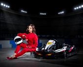 stock photo of armored car  - Young girl karting driver at sports hall - JPG