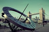 picture of sundial  - Tower Bridge and sundial over Thames River in London - JPG
