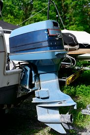 foto of outboard engine  - a blue outboard engine with a propeller - JPG