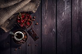stock photo of black-cherry  - Coffee cup dark chocolate and cherries on the wooden table - JPG