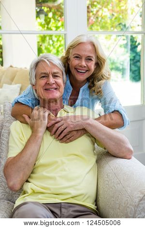 Portrait of happy senior couple embracing at home