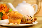 picture of orange-juice  - breakfast with cranberry muffins teapot and orange juice on bamboo mat - JPG