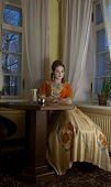 stock photo of 1700s  - baroque portrait in cafe in medieval Tallinn - JPG
