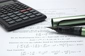 Calculator And Pen On Scientific Paper