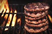 Bbq Grilled Burgers Patties On The Hot Flaming Grill poster