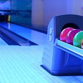 colored bowling balls in a row