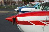 stock photo of cessna  - a row of colorful cessna aircraft lined up ready for action - JPG
