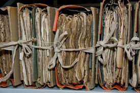stock photo of annal  - Very old paper records in storing room - JPG