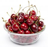 cherries on glass bowl isolated