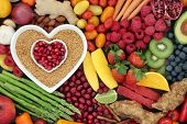 Health food for heart fitness with seeds, vegetables, fruit, nuts, herbs and spice. Super food conce poster