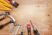 Assorted work tools on wood poster